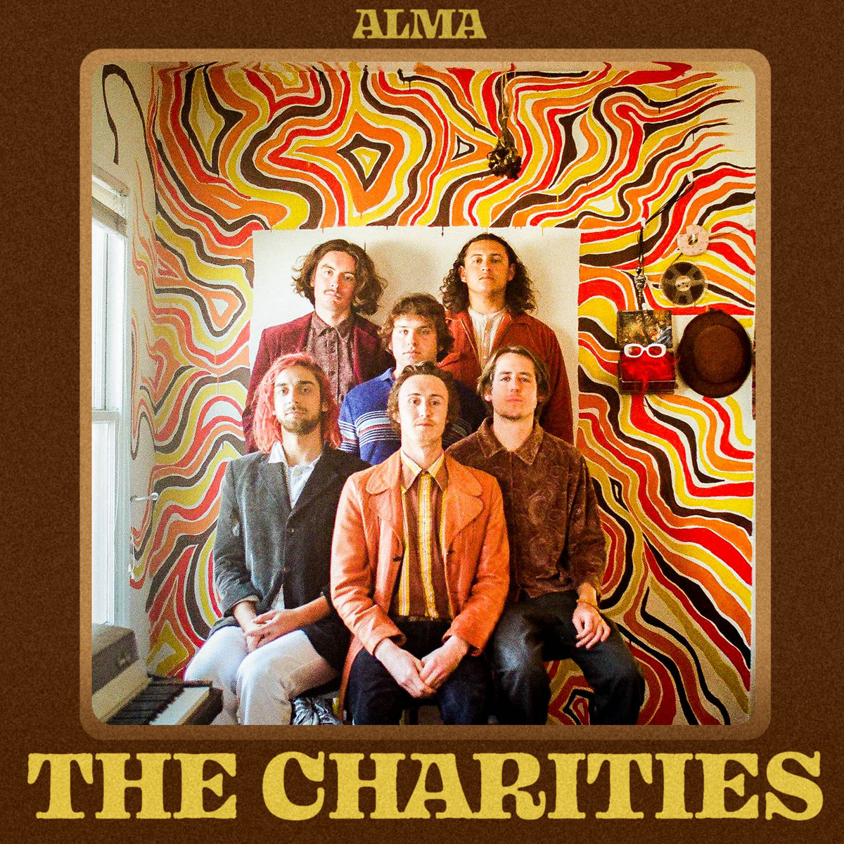 Album cover art for Alma by The Charities